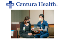 Two healthcare professionals talking at Centura Health